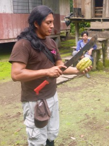 Fredy, our Amazon guide, hacking into a cacao seed pod for some sweet treats