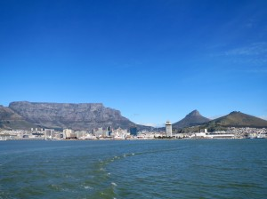 View of Cape Town from the bay.  Peaks from left to right: Table Mountain, Lion's Head, Signal Hill